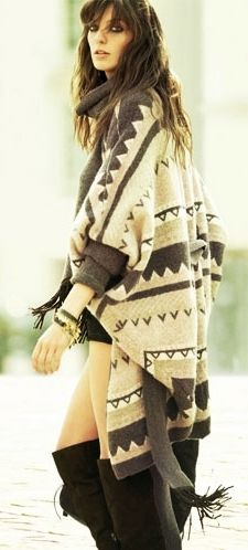 Love the boots with the short shorts and the long sweater!
