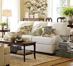 https://i.pinimg.com/236x/92/27/b7/9227b7286ddd06f14a0c6987bca3756f--white-couches-barn-living.jpg