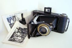 Old camera and Christmas photo cards.