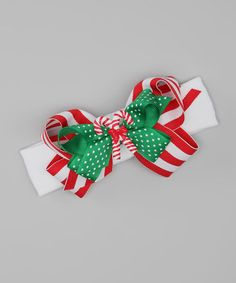 Take a look at this Red & White Stripe Candy Cane Stretch Headband by The Bow Lady on #zulily today!