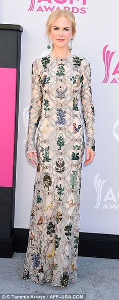Elegant but wild: The 49-year-old stunner's elegant form was accentuated by the floor sweeping frock