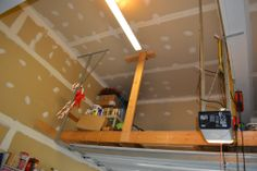 Diy garage storage loft suspended garage storage loft inspiration in home designing inspiration with suspended garage Attic Wardrobe, Attic Closet, Attic Playroom, Attic Office, Attic Library, Diy Garage Storage, Attic Storage, Attic Renovation, Attic Remodel