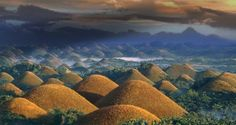 Chocolate hills.  Perfectly cone-shaped, the chocolate hills in Bohol, Philippines represent an amazing and unusual geological formation in the world. Most recent studies have shown that on an area of about 50 square kilometers in Bohol there are 1.776 hills covered in green grass that during the dry season turns brown. This spectacular hills are also featured on the provincial flag as a symbol of beauty in the province. Their height varies from 30 to 120 meters.