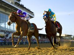 One for the Road - I'll Have Another, left, overtakes Bodemeister in the final stretch to win the 137th Preakness Stakes at Pimlico race course in Baltimore.