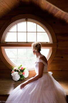 bride looking out of the window - Key West wedding  @Old Town Manor Weddings   @Just Save The Date Events  @Gail Mounier Marie-Pierre  #keywest #wedding #bride