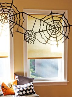 Blogger Jessica Jones simply cut up a trash bag in order to craft these cheap and easy spiderwebs.