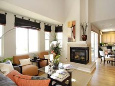 This classic fireplace sits in the corner between the family room and kitchen. Its asymmetrical opening makes the space appear larger.