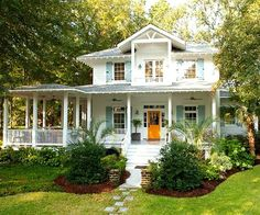 A bright painted front door is the perfect pop of color that adds an element of interest to the curb appeal.