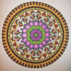 Done with markers and pencils. Mystical Mandala book.
