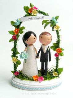 Make your own Wedding Cake Topper to look like you. Or, would a pair of porcelain Celtic hearts do?