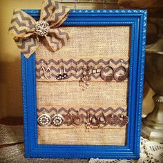 Earring holder made out of refinished picture frame and burlap!