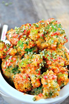 Feb 19, 2017 - Asian inspired fried broccoli, coated in panko and drizzled with a sweet and spicy bang bang sauce. Plant based and totally delicious!
