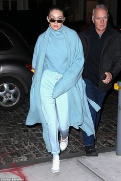 Don't be blue! Bella's sister Gigi, 22, wore a blue outfit that matched the model's eye co...