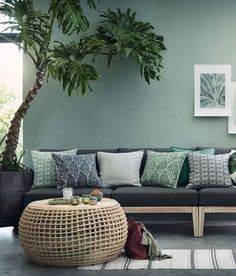 Botanical motifs in the new collection Warm Minimalism by H&M Home #interior #design #Home #decor #cozy #style #room #idea #inspiration  #sofa #cushion #green #color #paint #wall #couch
