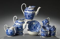 """English, ca 1820. A partial tea service in medium dark blue consisting of six handled cups and saucers, two teapots and a cream pitcher. Most pieces marked with blue printed underglaze DAVENPORT; teapots are 8.5"""" and 7.5"""" high; cups are 2.25"""" high, saucers are 5.25"""" diameter, cream pitcher is 4.5"""" high.  Sold for 420.00 USD @ a British Auction."""