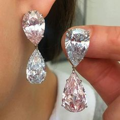 Spectacular earrings featuring two Fancy Light Pink diamonds weighing and carats, and two Fancy Light Blue diamonds weighing and carats. Gem Diamonds, Colored Diamonds, Diamond Jewelry, Diamond Earrings, Stone Earrings, Diy Earrings, Beautiful Earrings, Modern Jewelry, Jewelry Collection