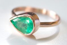 Emerald And Rose Gold Teardrop Ring