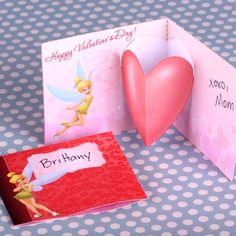 Send a heartfelt Valentine's Day message with Tinker Bell's flitterific pop-up card!