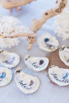 Oster shell escort cards with calligraphy by Laura Hooper for a Captiva Island Wedding. Photo by hunterryanphoto.com