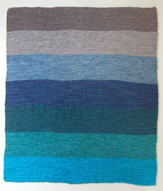 these knit blankets are done in so many beautiful colors. this one reminds me of the ocean. love it.