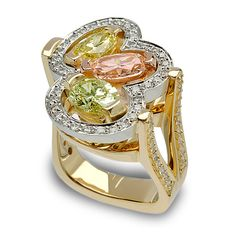 A trio of Chameleon Yellowish Green, Light Salmon Pink and Fancy Yellow Oval Cut Diamonds surrounded by Round Brilliant Cut Diamonds set in 18K Green, Rose and Yellow Gold and Platinum