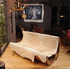 """Jose Zanine Caldas - Sofa - 1970s. Wood and hide bench made in Brazil, side branded with """"Zanine""""."""