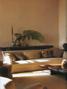 like the idea of a shallow shelf behind sofa. Good for coffee and for decor items. Nice dark slab of recycled timber.