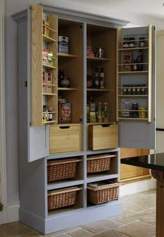 Pantry Modern kitchens often lack charm. This vintage armoire delivers old-fashioned appeal while also supplying organized storage for pantry items. The door's interior panels are outfitted for spices and smaller packaged goods, while the baskets held below are a portable alternative to stationary drawers.