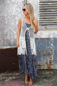 Cotton, acrylic blended. Ivory in color. Crochet + fringe vest. Front tie -- Tie it, or dont! Either way, it's precious! Perfect addition to any of this summers