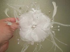 diy wedding flower for hair? @Kathie S want to try to attempt to make one like the one i tried on at the bridal store? :)