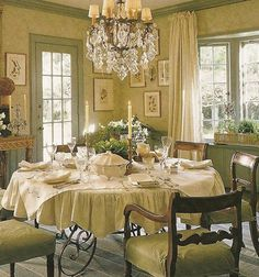 English Country Style Dining Room ...with White TableCloth / candles / place settings ... etc. Windows and GORGEOUS Chandelier