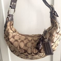 """Signature """"C"""" Coach Shoulder Bag Classic signature """"C"""" monogram shoulder bag. Practically pristine.   Bought this quite some time ago when I first discovered a love for designer handbags lol but I ended up only carrying it a handful of times because I was so young.   Feel free to do offers over my eBay, I do not take offers through comments because people never commit lol. Coach Bags Shoulder Bags"""
