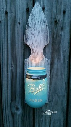 Scrap pieces of reclaimed picket fencing make great mason jar candle holders, sconces and vases. Add a little whitewash, and these rustic beauties can be used indoors and out.