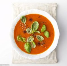 5:2 Roasted Red Pepper Soup, serves 4 (58 cals)3 large red peppers, 3 ripe plum tomatoes, 1 onion, 3 garlic cloves, 1 tbsp olive oil, salt and pepper, pinch of sugar, 1 tsp cumin seeds, chilli flakes to taste, juice and zest of ½ a lemon, 1 litre chicken stock, 2 tsp tomato purée, 1 tsp balsamic vinegar, basil leaves