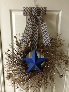 Americana wreath with a metal star in the center and red,white & blue pip berries and little rusted metal stars. $60  http://dreamininburlap.wix.com/dreaminwreaths