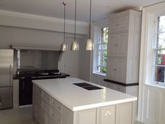 Free standing kitchen furniture in Little Greene French grey and French grey dark.