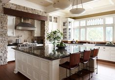 Love the texture that adding the element of stone brings to this kitchen