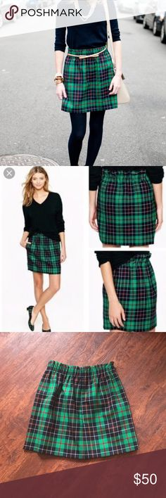 J. Crew green tartan plaid city mini skirt LIKE NEW J. Crew plaid mini skirt! This is a highly sought after skirt and is pretty hard to come by. Size 2, fits true to size, but could also work for a 4 because of the elastic waistband. I'm only selling because I'm trying to drastically reduce my wardrobe. It's in perfect condition and ready for fall and winter! J. Crew Skirts Mini