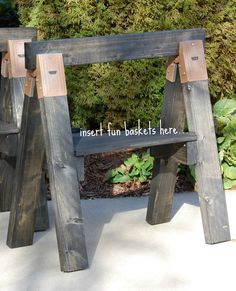 Put reclaimed wood into sawhorse brackets, attach either a glass top (for desk or table) or reclaimed wood top.