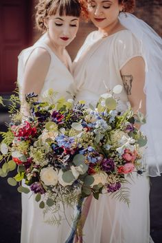 emma bauso photography styled shoot brides holding large, colorful spring floral bouquets