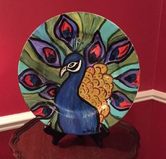 Hey, I found this really awesome Etsy listing at https://www.etsy.com/il-en/listing/399061117/hand-painted-peacock-plate-with-standby