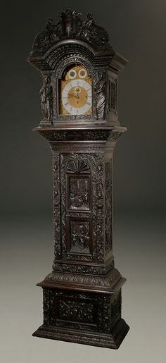 English tall case, fully carved black oak case, 8 day  19th century English tallcase clock fully carved in black oak. Plays the Westminster on a set of gongs. Circa 1870. $23,850.00