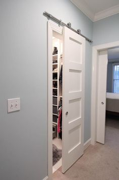 DIY 5 panel barn door with stainless steel sliding hardware - Paper Daisy Design