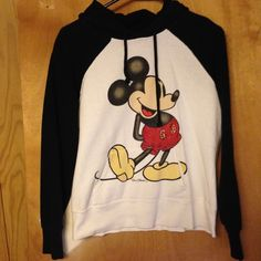 Mickey Mouse hoodie Here's a cute Mickey Mouse hoodie! There's no size tag, but it fits like a medium. I believe it's a junior size. It's in pre loved condition with some pilling and dryer fuzzies, but it still has plenty of life left! Tops Sweatshirts & Hoodies