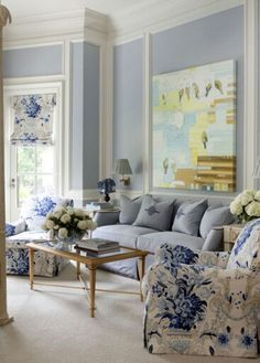 Sherwin-Williams Krypton, which is a lovely shade of pale. And when paired with Sherwin-Williams Creamy on the trim, it gives the effect of stepping into a piece of Wedgwood china.