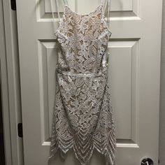 White Signature Lace | Size Large Large White Lace Dress with tie back. Adorable and sexy! Tags attached - never worn!! Signature Dresses Mini