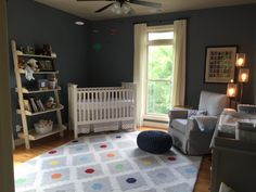 Shades of gray and a pop of color in baby boy's nursery.