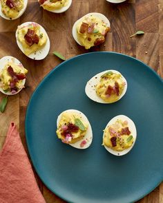 A recipe for deviled eggs flavored with sage and shallots and topped with bacon, perfect as an appetizer for Thanksgiving. Thanksgiving Deviled Eggs, Thanksgiving Appetizers, Thanksgiving Ideas, Holiday Ideas, Egg Recipes, Cooking Recipes, Recipies, Dinner Recipes, Deviled Eggs Recipe