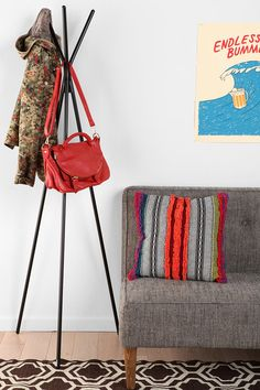 free up some closet space by putting your heavy rotation coat and bag on a coat rack or hook by the door #organize #storage
