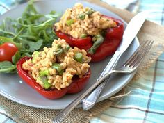 Roasted red pepper halves are stuffed with rich vegan risotto studded with bits of sun-dried tomatoes, asparagus, and creamied up with blended raw cashews.